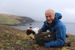 H Weimerskirch with a juvenile wandering albatross. Photo H Weimerskirch.