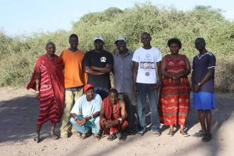Figure 15. The permanent field team of the Amboseli Baboon Research Project, responsible for the large majority of the regular monitoring and data collection. Raphael Mututua (center, back row) is the Project Manager and has been working with the Amboseli Baboon Research Project since 1981. Back row from left: Moonyoi ole Parsetau (camp staff), Lenkai 'Nkii' ole Rikoyan (camp cook), Jackson Kinyua Warutere (Senior Observer), Raphael Supeet Mututua (Project Manager and Senior Observer), Isaiah Longida ole Siodi (Observer), Serah Sayialel (Senior Observer), Benard Ochieng' Oyath (Junior Observer). Front row from left: Gideon Marinka (Junior Observer), Lenkai 'Alex' ole Meloimet (camp staff). Photo credit: Kerri Smith.